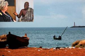 TAKORADI, Ghana - A traditional fishing boat sails in the Gulf of Guinea near the fishing village of Takoradi, west of Ghana's capital, Accra, on March 2, 2009. U.S. Africa Command's civilian deputy, Ambassador Mary C. Yates, met with local fishermen to discuss ways that maritime security programs can protect fishing stocks, which are a vital source of food in West Africa. Inset: Nana Ekow Akon, chief of the Takoradi fishing community, speaks with U.S. Africa Command's civilian deputy, Ambassador Mary C. Yates, on March 2, 2009. Yates visited West Africa to discuss international cooperation in illegal fishing, counter-narcotics and illicit trafficking. (Photos by Vince Crawley, U.S. Africa Command)