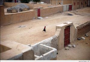 A young child runs through a deserted side street in Gao, northern Mali, on Jan. 28, 2013, the day after French and Malian troops secured a strategic bridge and the airport.